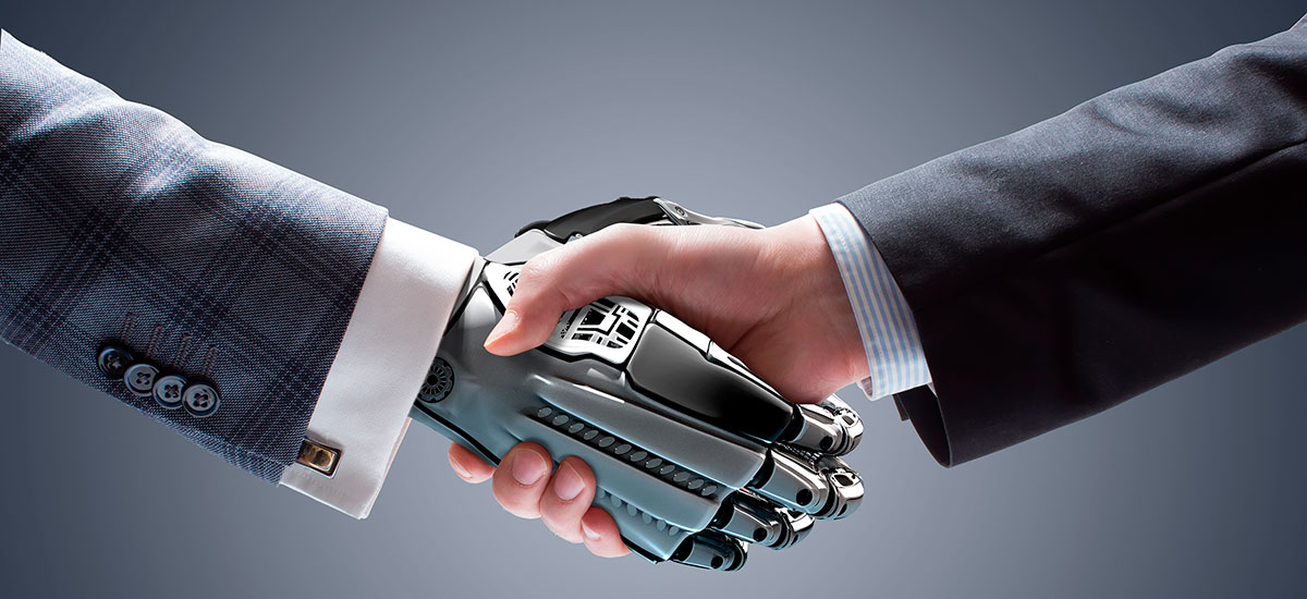 A handshake of human and robot wearing business suits