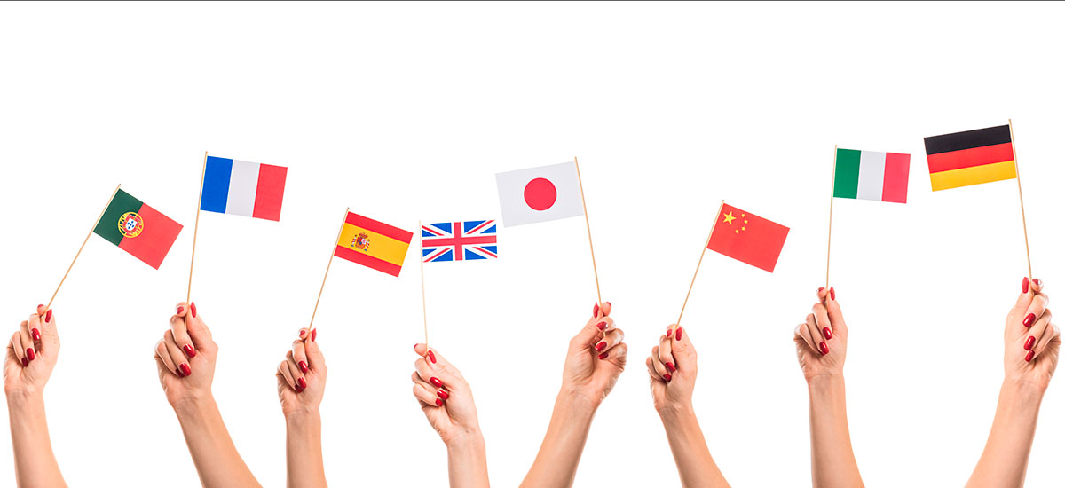 Hands hold national flags of Portugal, France, Spain, Great Britain, Japan, China, Italy, and Germany