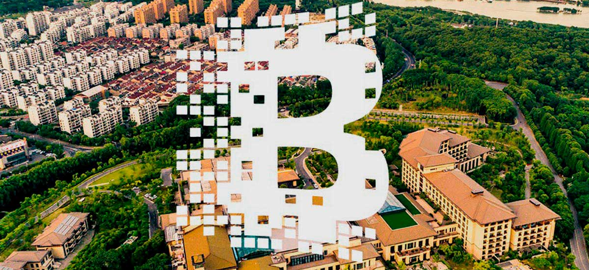 Bitcoin icon and city buildings on the background