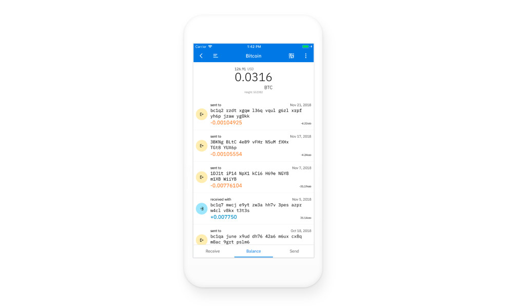 A phone with Coinomi app running