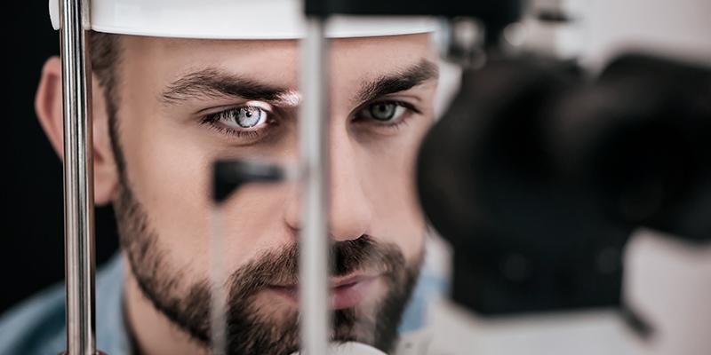 A human eye being analyzed by retina diagnostics device