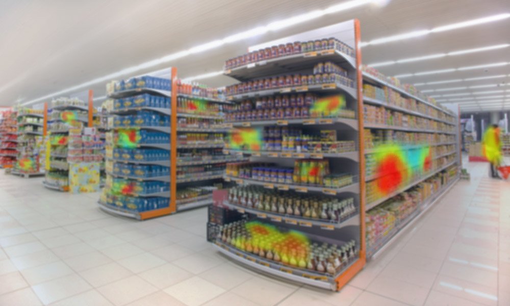 Shelves in a grocery store with red and yellow zones illustrating customers' buying habits